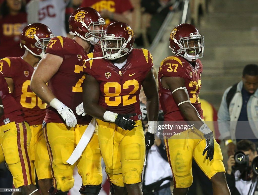 Running back Javorius Allen #37 of the USC Trojans celebrates with tight end Randall Telfer #82 after scoring on a four yard touchdown run in the fourth quarter against the Arizona Wildcats at Los Angeles Coliseum on October 10, 2013 in Los Angeles, California. USC won 38-31.