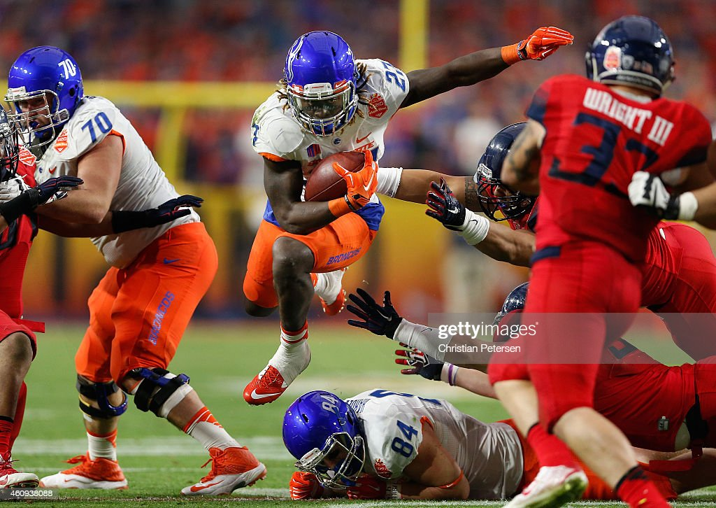Running back Jay Ajayi of the Boise State Broncos rushes the football against the Arizona Wildcats during the first quarter of the Vizio Fiesta Bowl...
