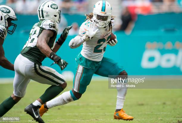 Running back Jay Ajayi of the Miami Dolphins carries the ball during a NFL game against the New York Jets at Hard Rock Stadium on October 22 2017 in...