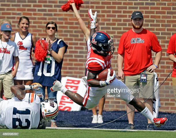 Running back Jaylen Walton of the Mississippi Rebels gets past safety Taino FearsPerez of the Tennessee Martin Skyhawks for a touchdown during the...