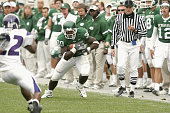Running back Jehuu Caulcrick of the Michigan State Spartans carries the ball against the Northwestern Wildcats at Spartan Stadium on October 22 2005...