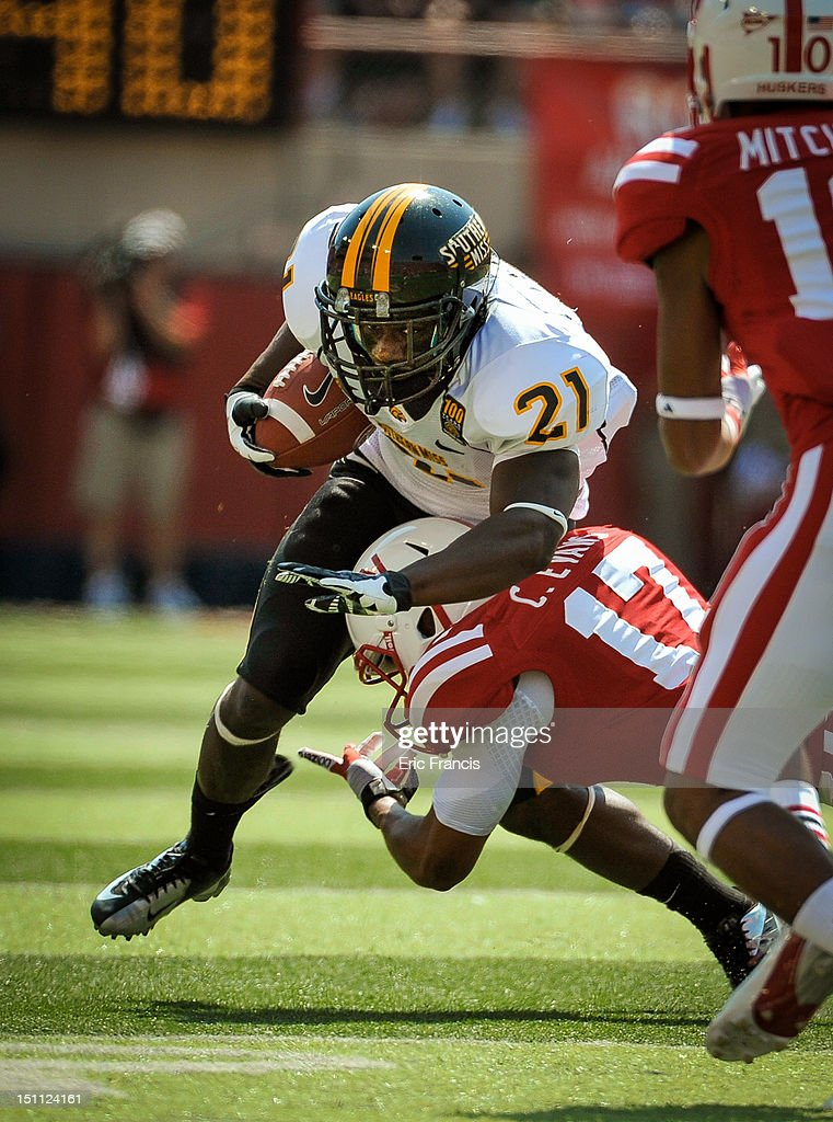Running back Jeremy Hester #21 of the Southern Miss Golden Eagles gets hit by cornerback Ciante Evans #17 of the Nebraska Cornhuskers during their game at Memorial Stadium September 1, 2012 in Lincoln, Nebraska. Nebraska won 49-20.