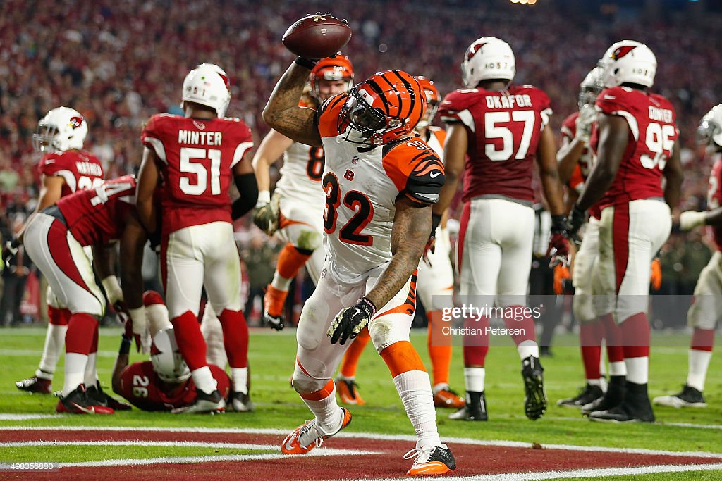 Running back Jeremy Hill #32 of the Cincinnati Bengals celebrates after scoring on a two yard rushing touchdown against the Arizona Cardinals during the second quarter of the NFL game at the University of Phoenix Stadium on November 22, 2015 in Glendale, Arizona.
