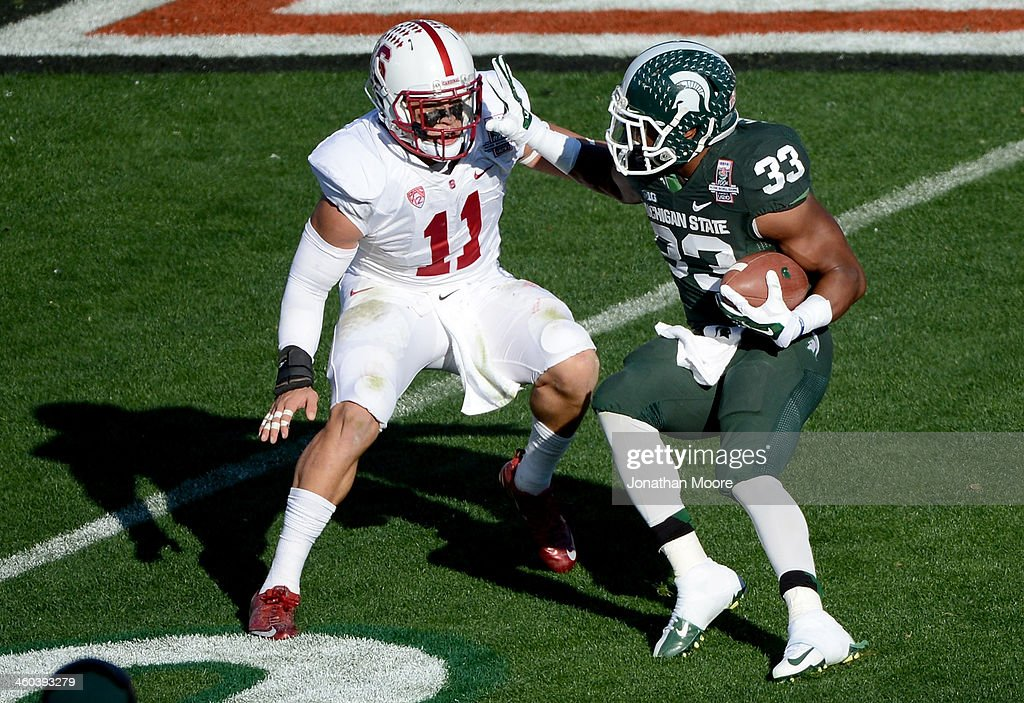 Running back Jeremy Langford #33 of the Michigan State Spartans runs the ball against linebacker <a gi-track='captionPersonalityLinkClicked' href=/galleries/search?phrase=Shayne+Skov&family=editorial&specificpeople=6362886 ng-click='$event.stopPropagation()'>Shayne Skov</a> #11 of the Stanford Cardinal during the 100th Rose Bowl Game presented by Vizio at the Rose Bowl on January 1, 2014 in Pasadena, California.