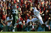 Running back Jeremy Langford of the Michigan State Spartans rushes with the ball against the Stanford Cardinal during the 100th Rose Bowl Game...