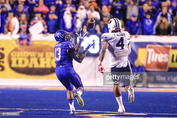Running back Jeremy McNichols of the Boise State Broncos catches a 76 yard touchdown pass over the defense of linebacker Fred Warner of the Brigham...