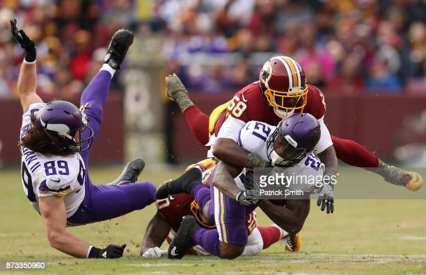 Running back Jerick McKinnon of the Minnesota Vikings is tackled by linebacker Junior Galette of the Washington Redskins during the fourth quarter at...