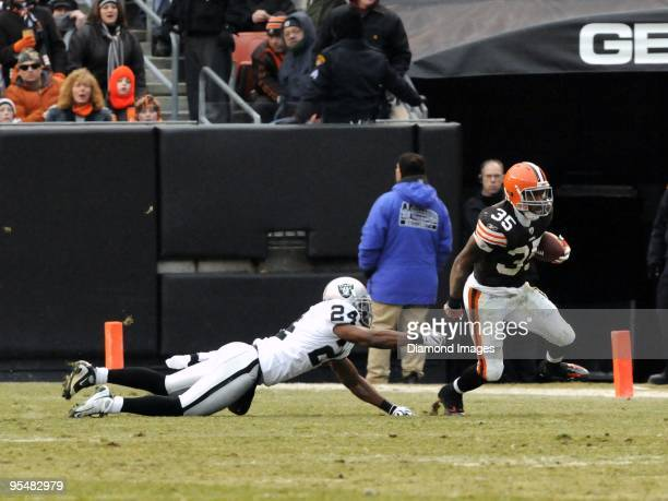 Running back Jerome Harrison of the Cleveland Browns runs away from defensive back Michael Huff of the Oakland Raiders during a game on December 27...