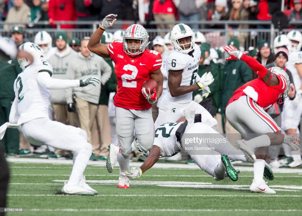 Running back J.K. Dobbins #2 of the Ohio State Buckeyes runs with the ball during the game between the Ohio State Buckeyes and the Michigan State Spartans on November 11, 2017 at the Ohio Stadium in Columbus, Ohio. Ohio State Buckeyes won 48-3.