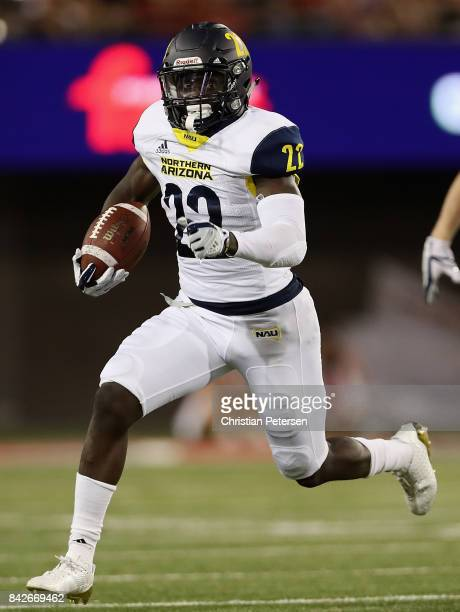 Running back Joe Logan of the Northern Arizona Lumberjacks rushes the football during the college football game against the Arizona Wildcats at...