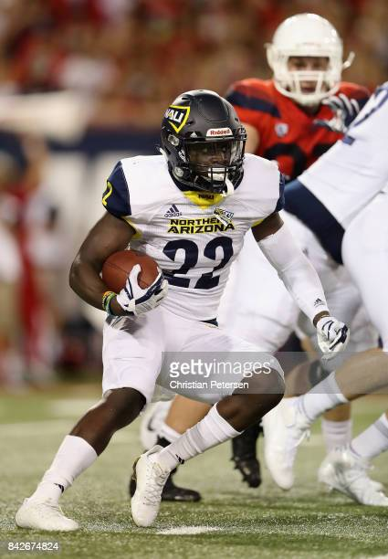 Running back Joe Logan of the Northern Arizona Lumberjacks rushes the football against the Arizona Wildcats during the college football game at...