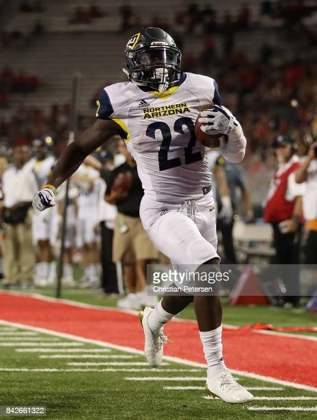 Running back Joe Logan of the Northern Arizona Lumberjacks scores on a 22 yard rushing touchdown against the Arizona Wildcats during the second half...