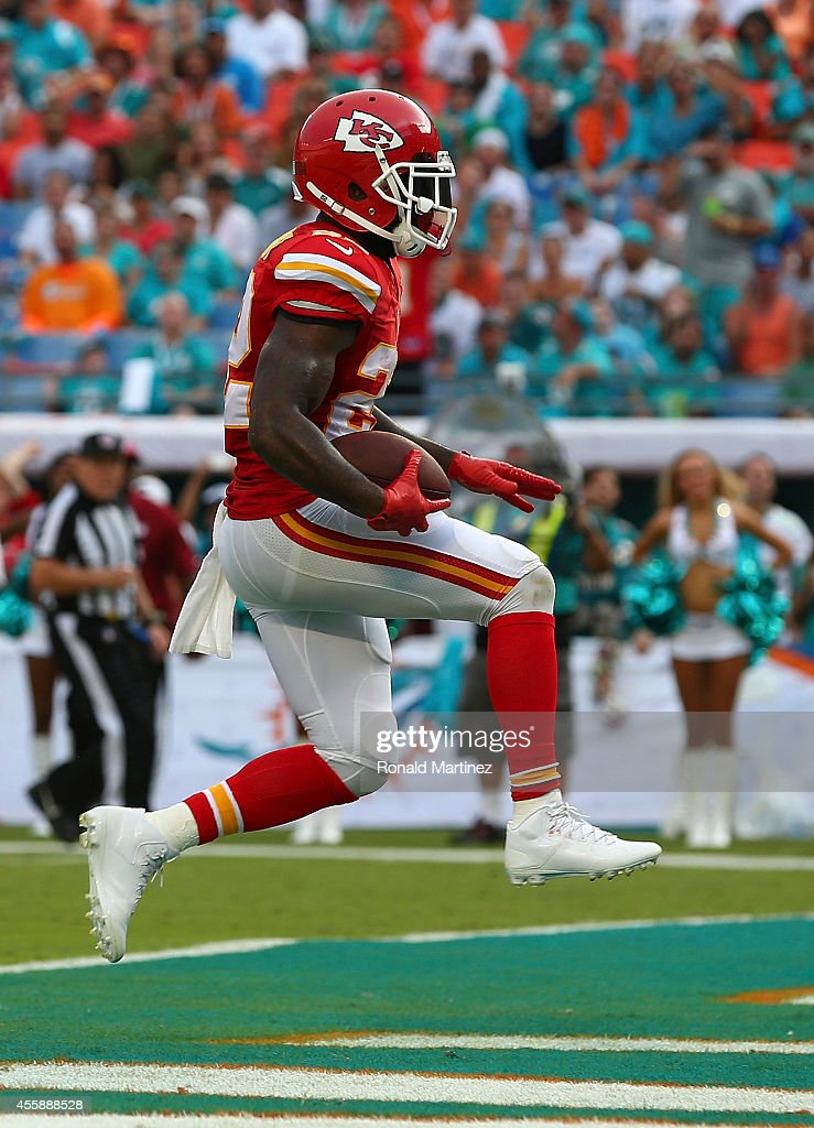 Running back Joe McKnight #22 of the Kansas City Chiefs scores a third-quarter touchdown against the Miami Dolphins at Sun Life Stadium on September 21, 2014 in Miami Gardens, Florida.