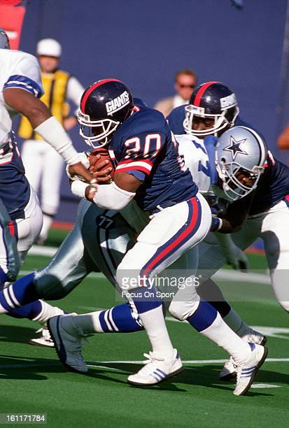 Running back Joe Morris of the New York Giants carries the ball against the Dallas Cowboys during an NFL football game circa 1985 at the Meadowlands...
