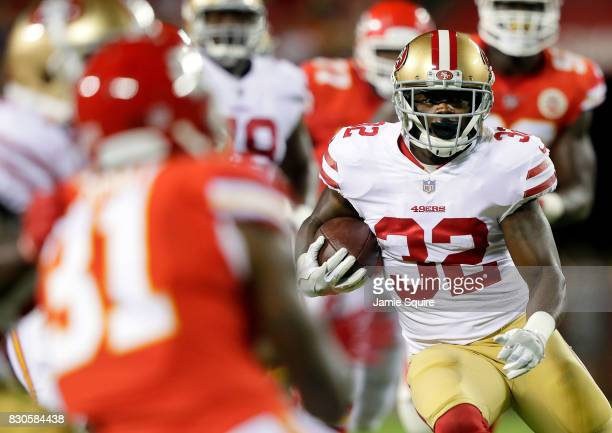 Running back Joe Williams of the San Francisco 49ers carries the ball during the preseason game against the Kansas City Chiefs at Arrowhead Stadium...