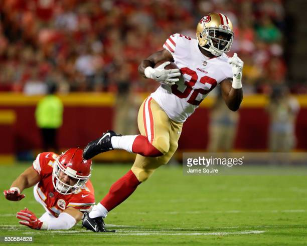 Running back Joe Williams of the San Francisco 49ers carries the ball as linebacker Marcus Rush of the Kansas City Chiefs defends during the...