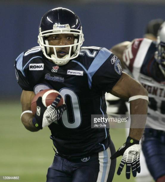 Running Back John Avery of the Toronto Argonauts runs for yardage vs the Montreal Alouettes in Canadian Football League action at Rogers Centre in...