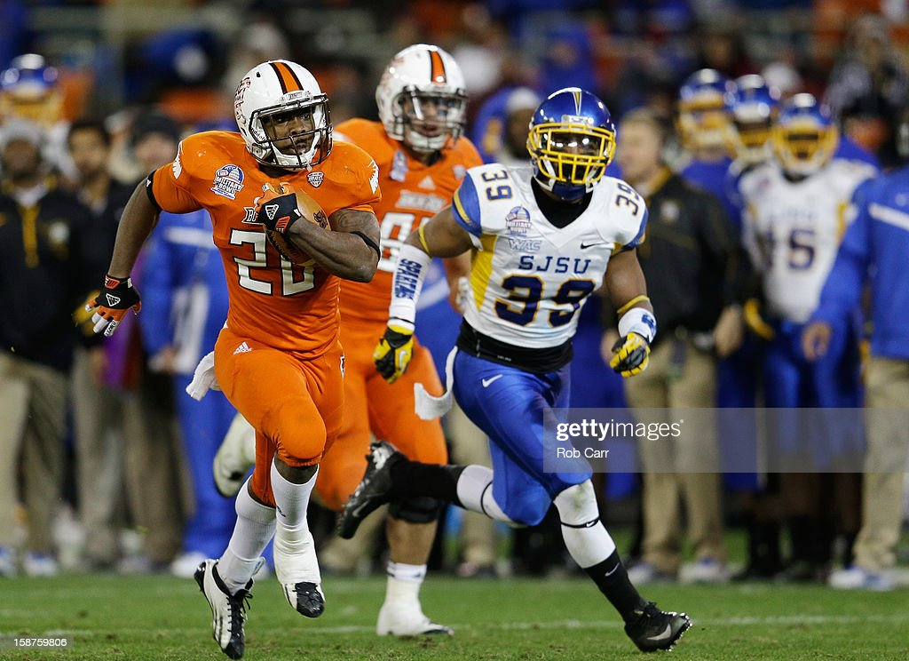 Running back John Pettigrew #20 of the Bowling Green Falcons carries the ball in front of safety Cullen Newsome #39 of the San Jose State Spartans during the second half of the Military Bowl at RFK Stadium on December 27, 2012 in Washington, DC.