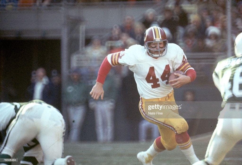 Running back John Riggins of the Washington Redskins runs upfield against the New York Jets at Shea Stadium on December 5 1976 in Flushing New York...