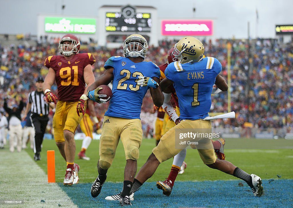 Running back <a gi-track='captionPersonalityLinkClicked' href=/galleries/search?phrase=Johnathan+Franklin&family=editorial&specificpeople=6235681 ng-click='$event.stopPropagation()'>Johnathan Franklin</a> #23 of the UCLA Bruins scores a touchdown against the USC Trojans at the Rose Bowl on November 17, 2012 in Pasadena, California. UCLA defeated USC