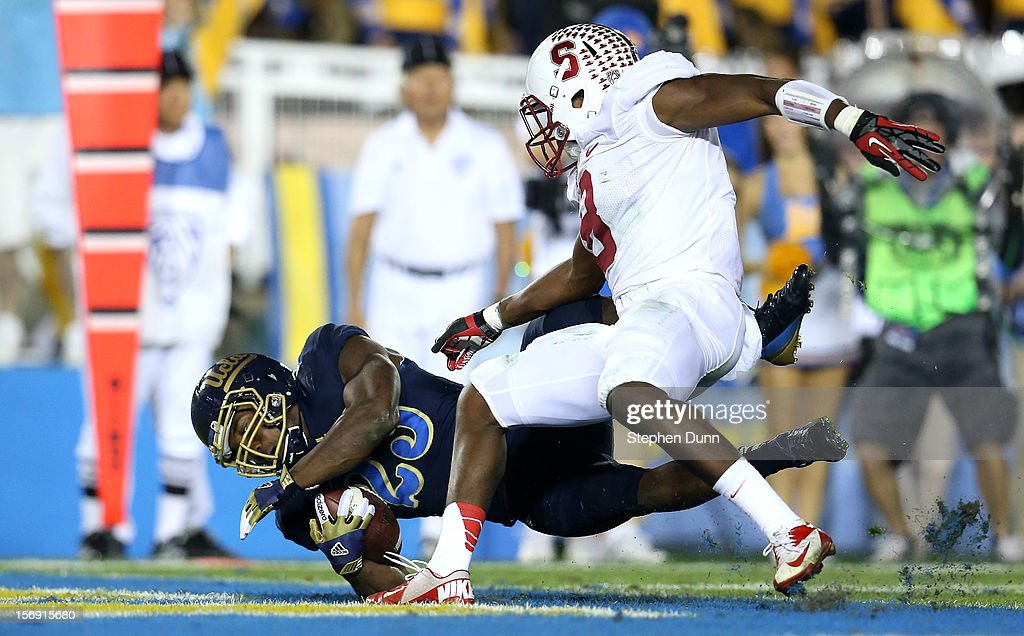 Running back <a gi-track='captionPersonalityLinkClicked' href=/galleries/search?phrase=Johnathan+Franklin&family=editorial&specificpeople=6235681 ng-click='$event.stopPropagation()'>Johnathan Franklin</a> #23 of the UCLA Bruins scores on an 11 yard touchdown run in the fourth quarter against safety Jordan Richards #8 of the Stanford Cardinal at the Rose Bowl on October 13, 2012 in Pasadena, California. Stanford won 35-17.