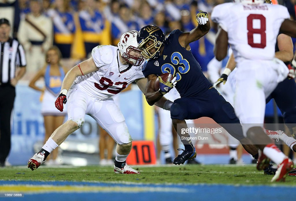 Running back <a gi-track='captionPersonalityLinkClicked' href=/galleries/search?phrase=Johnathan+Franklin&family=editorial&specificpeople=6235681 ng-click='$event.stopPropagation()'>Johnathan Franklin</a> #23 of the UCLA Bruins scores on an 11 yard touchdown run in the fourth quarter against linebacker Trent Murphy #93 of the Stanford Cardinal at the Rose Bowl on October 13, 2012 in Pasadena, California. Stanford won 35-17.