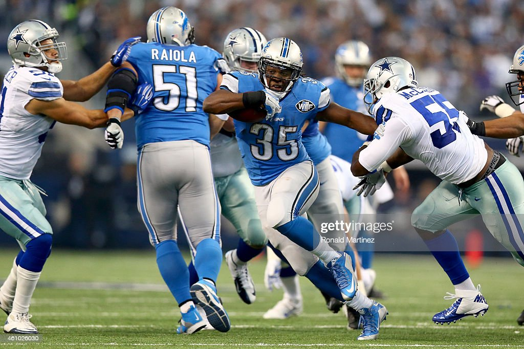 Running back Joique Bell of the Detroit Lions runs the ball against middle linebacker Rolando McClain of the Dallas Cowboys in the first half during...
