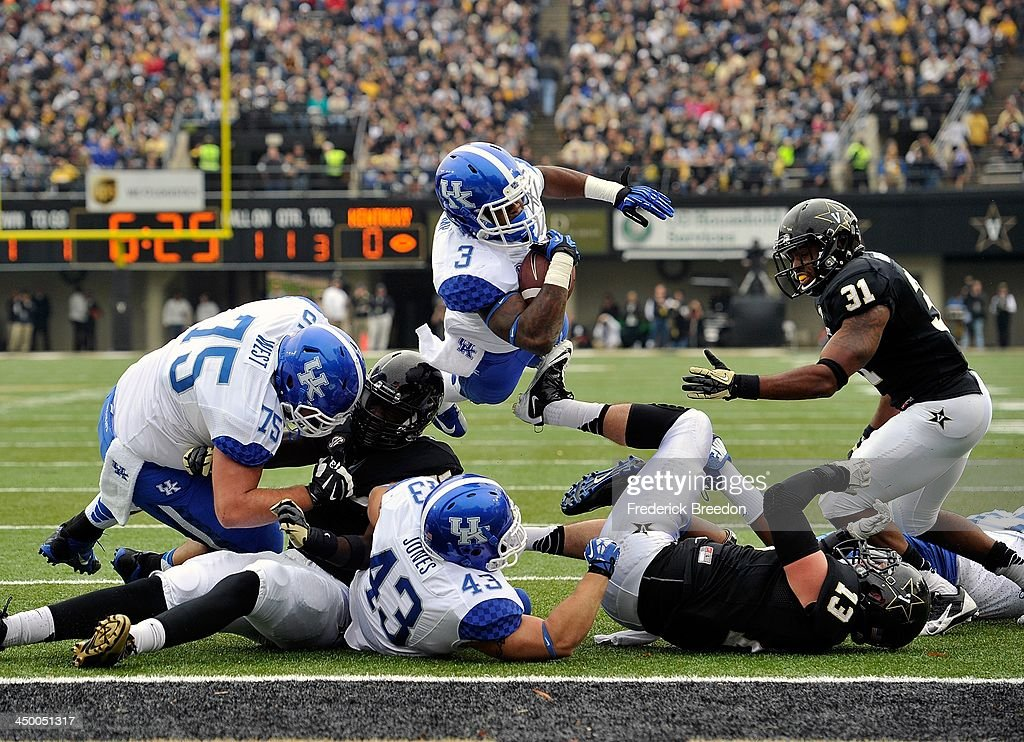 Running back Jojo Kemp #3 of the Kentucky Wildcats dives into the end zone for a touchdown against the Vanderbilt Commodores at Vanderbilt Stadium on November 16, 2013 in Nashville, Tennessee.