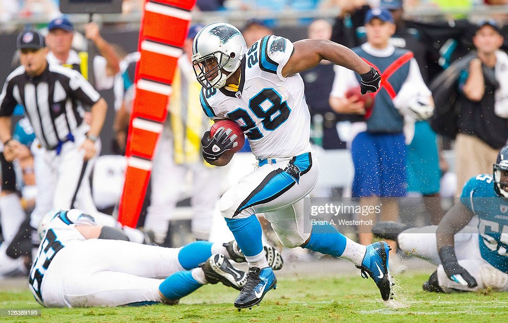Running back <a gi-track='captionPersonalityLinkClicked' href=/galleries/search?phrase=Jonathan+Stewart&family=editorial&specificpeople=2205176 ng-click='$event.stopPropagation()'>Jonathan Stewart</a> #28 of the Carolina Panthers breaks away for a long run against the Jacksonville Jaguars at Bank of America Stadium on September 25, 2011 in Charlotte, North Carolina. The Panthers defeated the Jaguars 16-10.