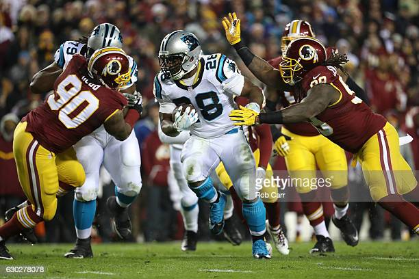 Running back Jonathan Stewart of the Carolina Panthers carries the ball against nose tackle Ziggy Hood and defensive end Ricky Jean Francois of the...