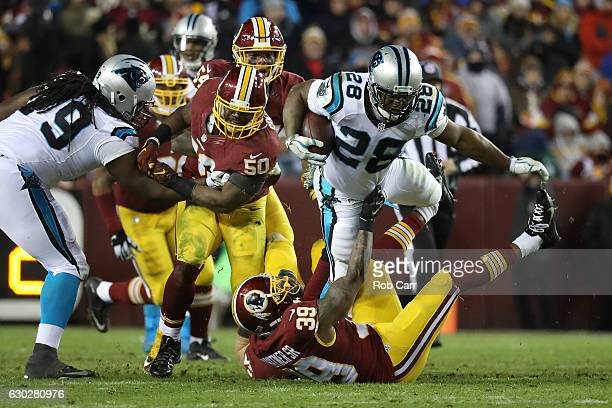 Running back Jonathan Stewart of the Carolina Panthers carries the ball against running back Keith Marshall of the Washington Redskins in the third...