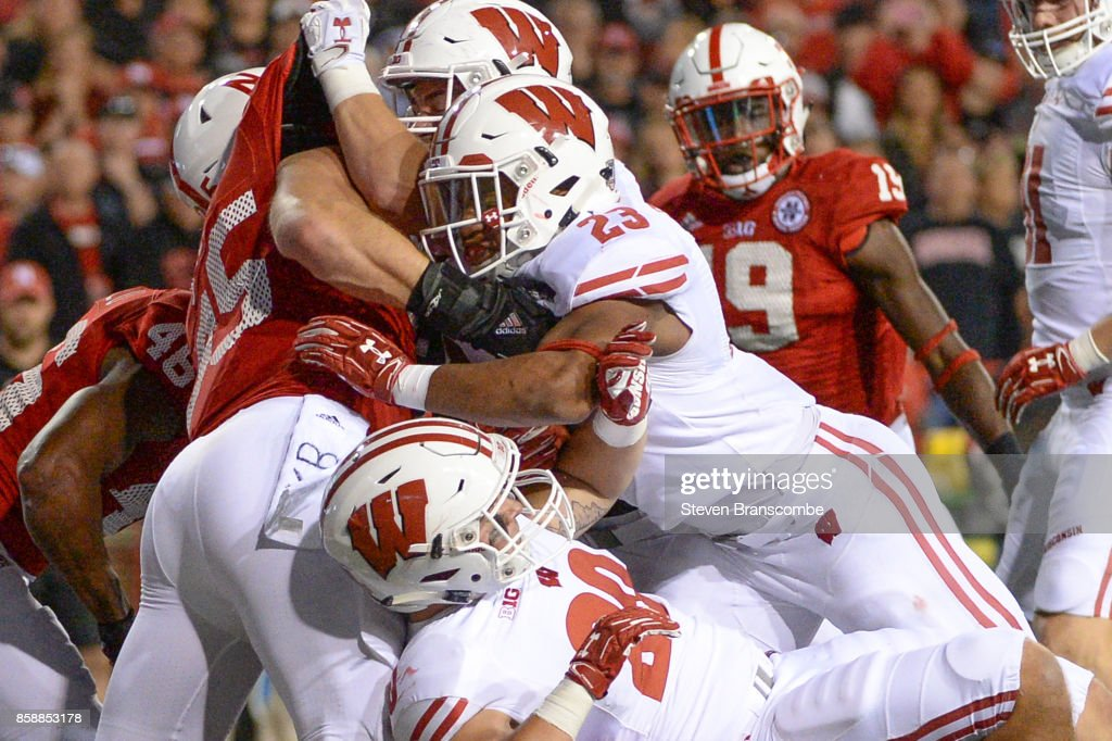 Running back Jonathan Taylor #23 of the Wisconsin Badgers reaches across the goal line to score against the Nebraska Cornhuskers at Memorial Stadium on October 7, 2017 in Lincoln, Nebraska.