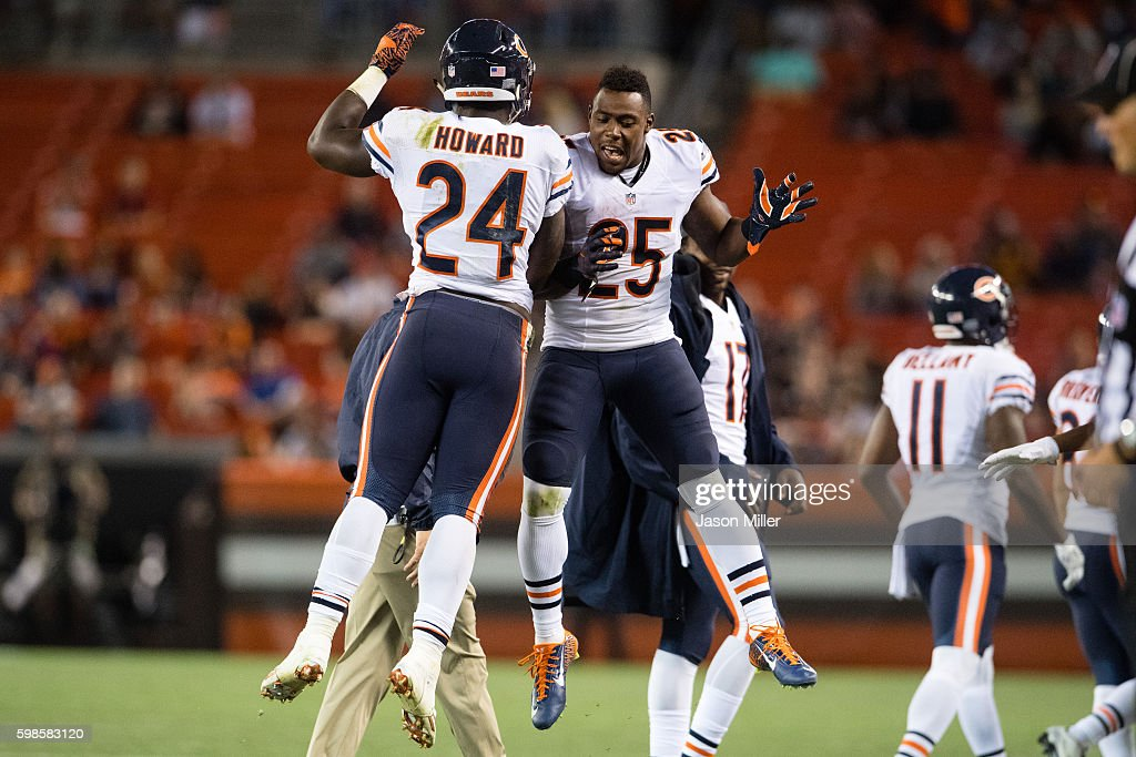 Running back Jordan Howard #24 celebrates with running back Ka'Deem Carey #25 of the Chicago Bears after Howard scored a touchdown during the fourth quarter against the Cleveland Browns at FirstEnergy Stadium during a preseason game on September 1, 2016 in Cleveland, Ohio. The Bears defeated the Browns 21-7.