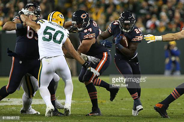 Running back Jordan Howard of the Chicago Bears carries the ball against inside linebacker Blake Martinez of the Green Bay Packers in the second...