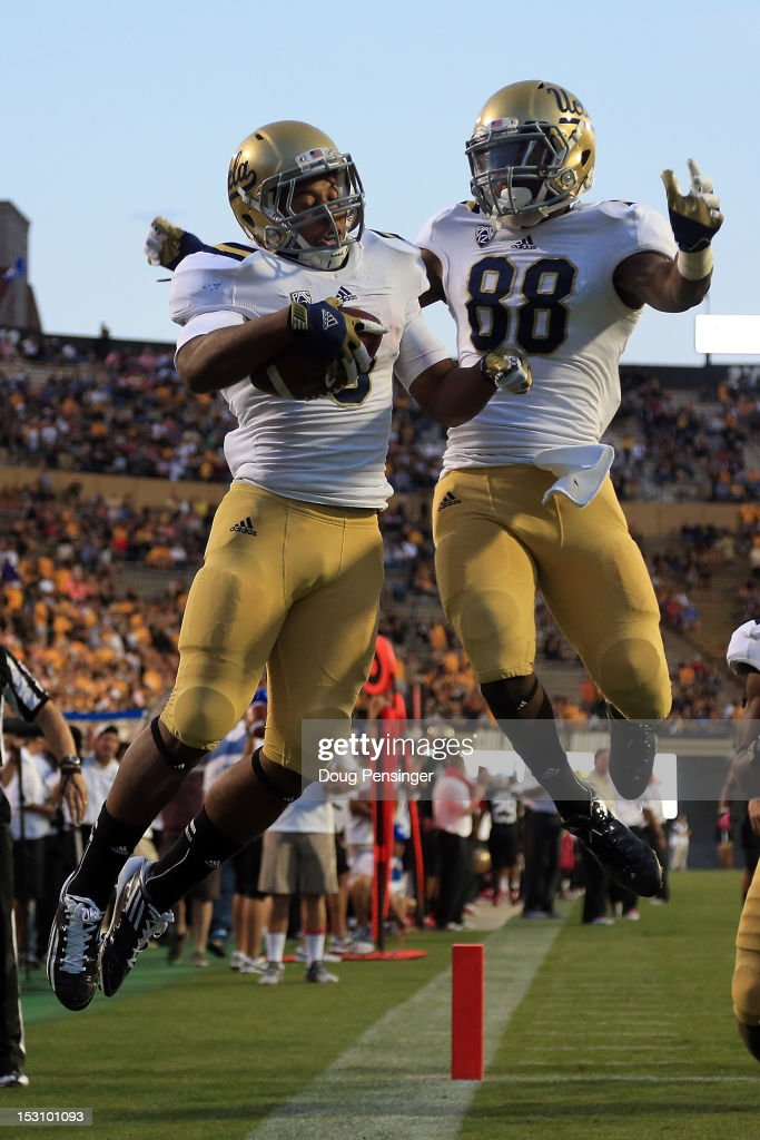 Running back Jordon James #6 of the UCLA Bruins celebrates his 25 yard touchdown run against the Colorado Buffaloes with wide receiver Jerry Rice Jr. #88 of the UCLA Bruins in the fourth quarter at Folsom Field on September 29, 2012 in Boulder, Colorado. UCLA defeated Colorado 42-14.