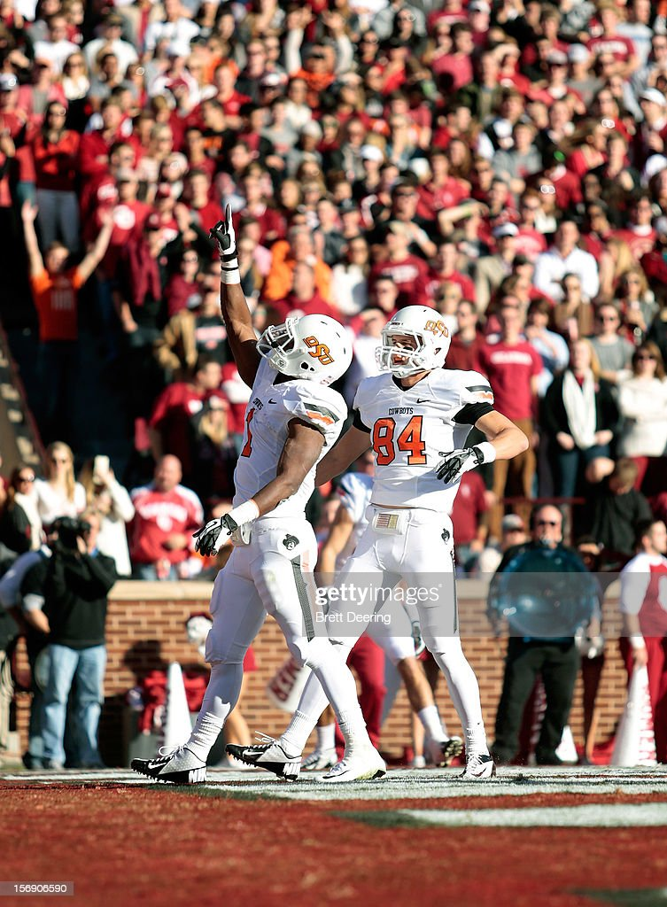 Running back Joseph Randle #1 and wide receiver Austin Hays #84 of the Oklahoma State Cowboys celebrate a touchdown against the Oklahoma Sooners November 24, 2012 at Gaylord Family-Oklahoma Memorial Stadium in Norman, Oklahoma.