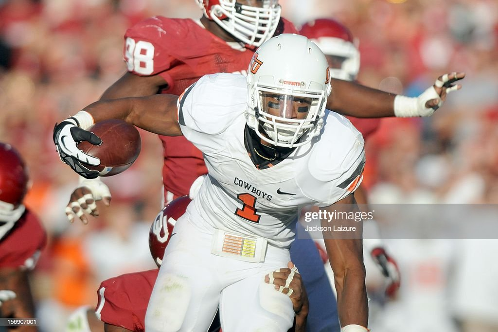 Running back Joseph Randle #1 of the Oklahoma State Cowboys looks for running room in the first half against the Oklahoma Sooners on November 24, 2012 at The Gaylord Family Oklahoma Memorial Stadium in Norman, Oklahoma.