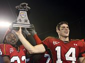 Running back Josh Allen and game MVP quarterback Sam Hollenbach of the Maryland Terrapins hold the winner's trophy after defeating the Purdue...