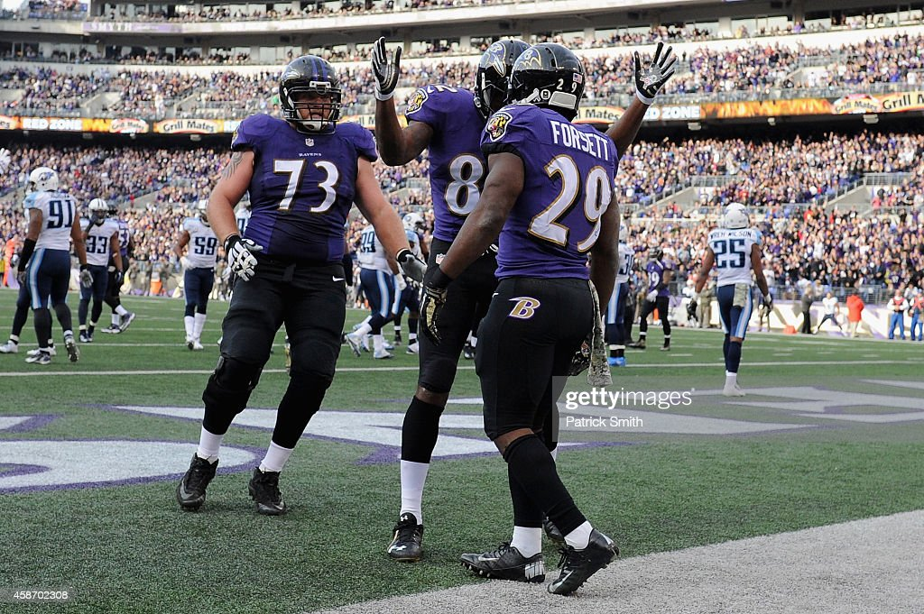 Running back <a gi-track='captionPersonalityLinkClicked' href=/galleries/search?phrase=Justin+Forsett&family=editorial&specificpeople=2205154 ng-click='$event.stopPropagation()'>Justin Forsett</a> #29 of the Baltimore Ravens is congratulated by teammates <a gi-track='captionPersonalityLinkClicked' href=/galleries/search?phrase=Torrey+Smith&family=editorial&specificpeople=5527843 ng-click='$event.stopPropagation()'>Torrey Smith</a> and <a gi-track='captionPersonalityLinkClicked' href=/galleries/search?phrase=Marshal+Yanda&family=editorial&specificpeople=2206873 ng-click='$event.stopPropagation()'>Marshal Yanda</a> after scoring a third quarter touchdown against the Tennessee Titans at M&T Bank Stadium on November 9, 2014 in Baltimore, Maryland.