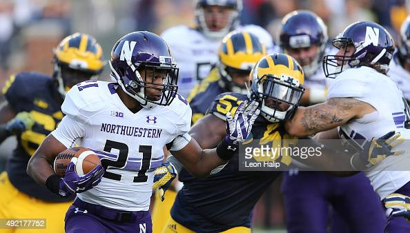 Running back Justin Jackson of the Northwestern Wildcats runs for a short gain during the first quarter of the game against the Michigan Wolverines...