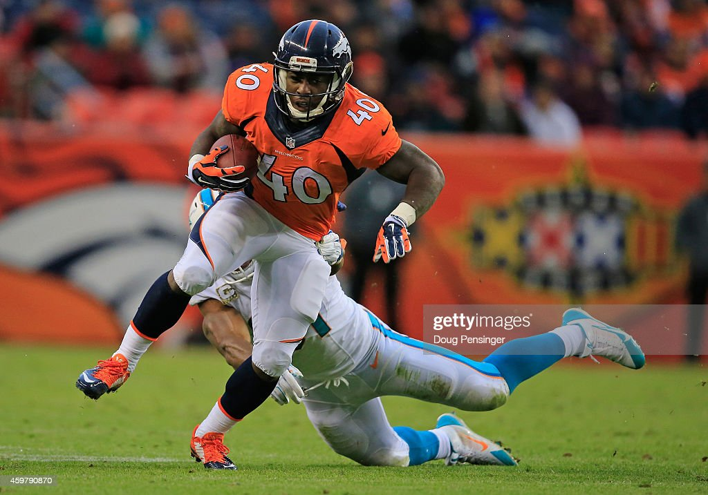 Running back <a gi-track='captionPersonalityLinkClicked' href=/galleries/search?phrase=Juwan+Thompson&family=editorial&specificpeople=7210888 ng-click='$event.stopPropagation()'>Juwan Thompson</a> #40 of the Denver Broncos carries the ball and eludes a defender againt the Miami Dolphins at Sports Authority Field at Mile High on November 23, 2014 in Denver, Colorado. The Broncos defeated the Dolphins 39-36.