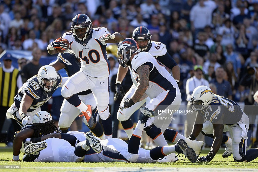 Running back <a gi-track='captionPersonalityLinkClicked' href=/galleries/search?phrase=Juwan+Thompson&family=editorial&specificpeople=7210888 ng-click='$event.stopPropagation()'>Juwan Thompson</a> #40 of the Denver Broncos jumps over the San Diego Chargers defense at Qualcomm Stadium on December 14, 2014 in San Diego, California.