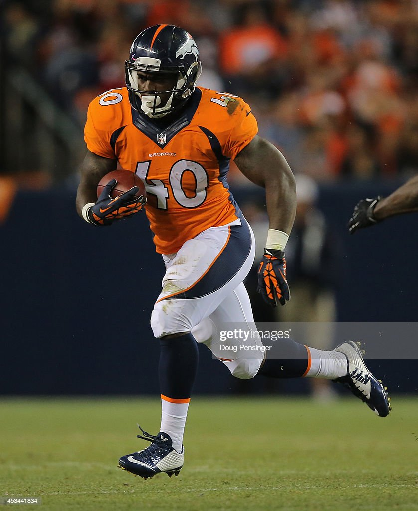 Running back <a gi-track='captionPersonalityLinkClicked' href=/galleries/search?phrase=Juwan+Thompson&family=editorial&specificpeople=7210888 ng-click='$event.stopPropagation()'>Juwan Thompson</a> #40 of the Denver Broncos runs with the ball against the Seattle Seahawks during preseason action at Sports Authority Field at Mile High on August 7, 2014 in Denver, Colorado. The Broncos defeated the Seahawks 21-16.