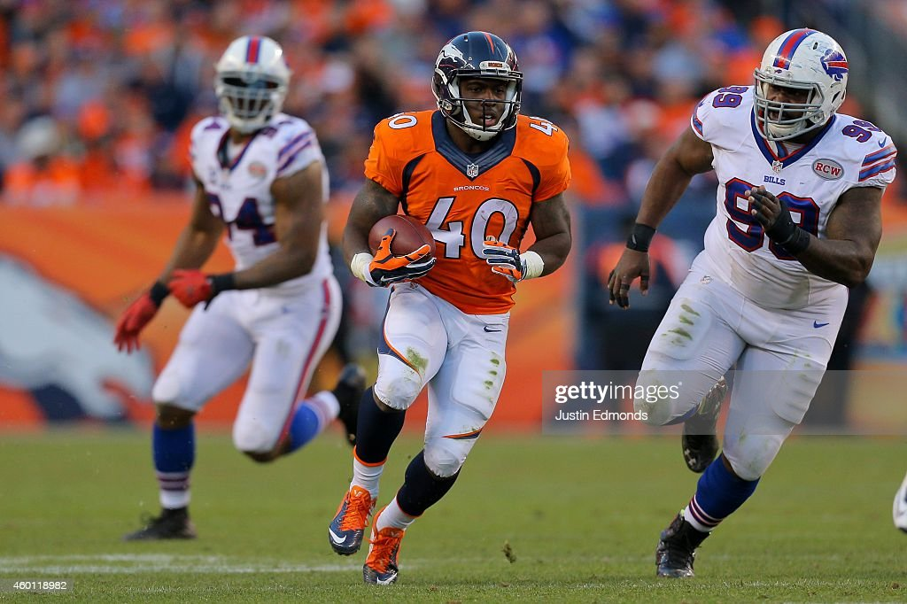 Running back <a gi-track='captionPersonalityLinkClicked' href=/galleries/search?phrase=Juwan+Thompson&family=editorial&specificpeople=7210888 ng-click='$event.stopPropagation()'>Juwan Thompson</a> #40 of the Denver Broncos runs with the ball during the third quarter before being tackled by defensive tackle <a gi-track='captionPersonalityLinkClicked' href=/galleries/search?phrase=Marcell+Dareus&family=editorial&specificpeople=6351513 ng-click='$event.stopPropagation()'>Marcell Dareus</a> #99 of the Buffalo Bills at Sports Authority Field Field at Mile High on December 7, 2014 in Denver, Colorado. The Broncos defeated the Bills 24-17.