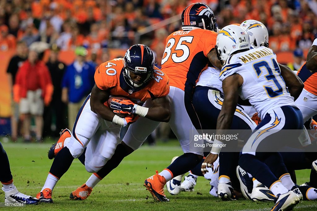Running back <a gi-track='captionPersonalityLinkClicked' href=/galleries/search?phrase=Juwan+Thompson&family=editorial&specificpeople=7210888 ng-click='$event.stopPropagation()'>Juwan Thompson</a> #40 of the Denver Broncos rushes for a 2 yard third quarter touchdown against the San Diego Chargers at Sports Authority Field at Mile High on October 23, 2014 in Denver, Colorado.