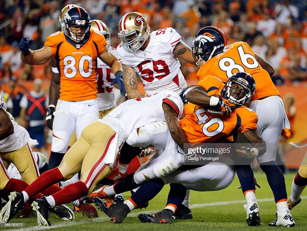 Running back <a gi-track='captionPersonalityLinkClicked' href=/galleries/search?phrase=Juwan+Thompson&family=editorial&specificpeople=7210888 ng-click='$event.stopPropagation()'>Juwan Thompson</a> #40 of the Denver Broncos surges into the endzone for a touchdown against the San Francisco 49ers during preseason action at Sports Authority Field at Mile High on August 29, 2015 in Denver, Colorado. The Broncos defeated the 49ers 19-12.