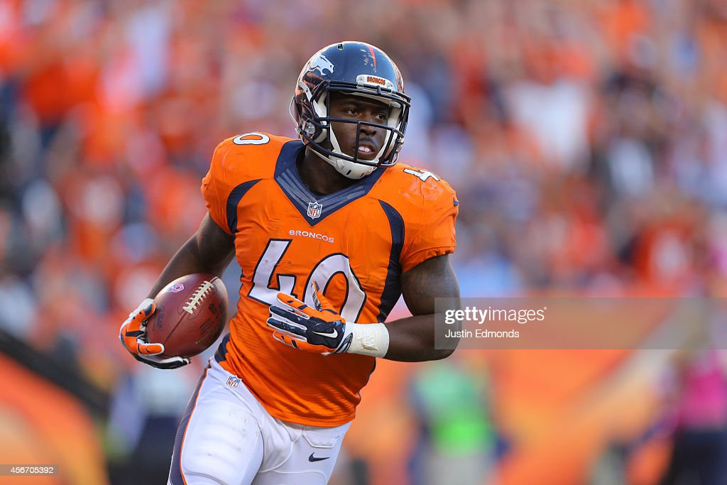 Running back <a gi-track='captionPersonalityLinkClicked' href=/galleries/search?phrase=Juwan+Thompson&family=editorial&specificpeople=7210888 ng-click='$event.stopPropagation()'>Juwan Thompson</a> #40 of the Denver Broncos turns after running for a fourth-quarter eight-yard rushing touchdown, his first career touchdown, against the Arizona Cardinals during a game at Sports Authority Field at Mile High on October 5, 2014 in Denver, Colorado.