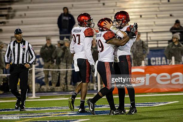 Running back Juwan Washington is congratulated by teammates after getting a touchdown against Nevada at Mackay Stadium on November 12 2016 in Reno...
