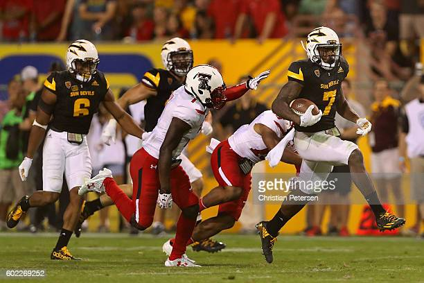 Running back Kalen Ballage of the Arizona State Sun Devils rushes the football for a 75 yard touchdown past defensive back Jah'Shawn Johnson of the...