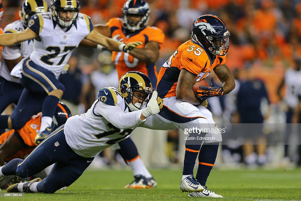 Running back Kapri Bibbs #35 of the Denver Broncos escapes the grasp of offensive tackle Ian Seau #72 of the Los Angeles Rams during the fourth quarter at Sports Authority Field at Mile High on August 27, 2016 in Denver, Colorado. The Broncos defeated the Rams 17-9 in pre-season action.